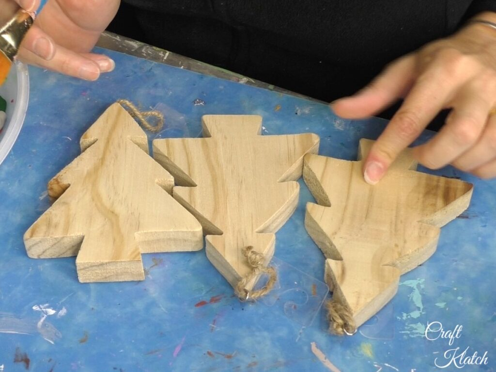 Three unfinished wood Christmas trees