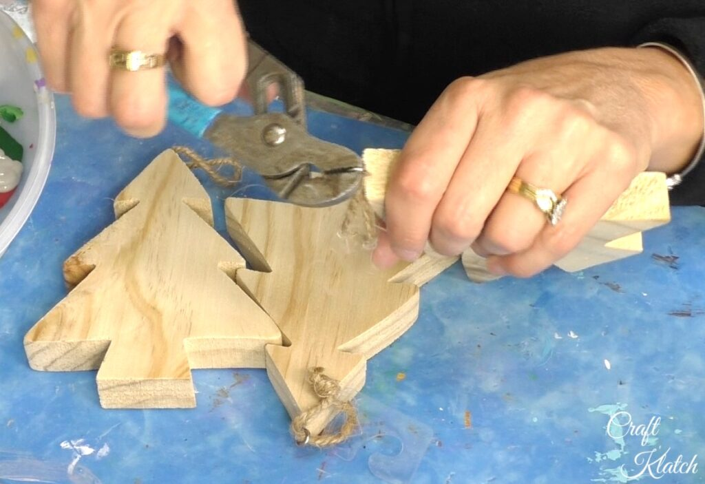 Remove eye screw from unfinished wood Christmas trees