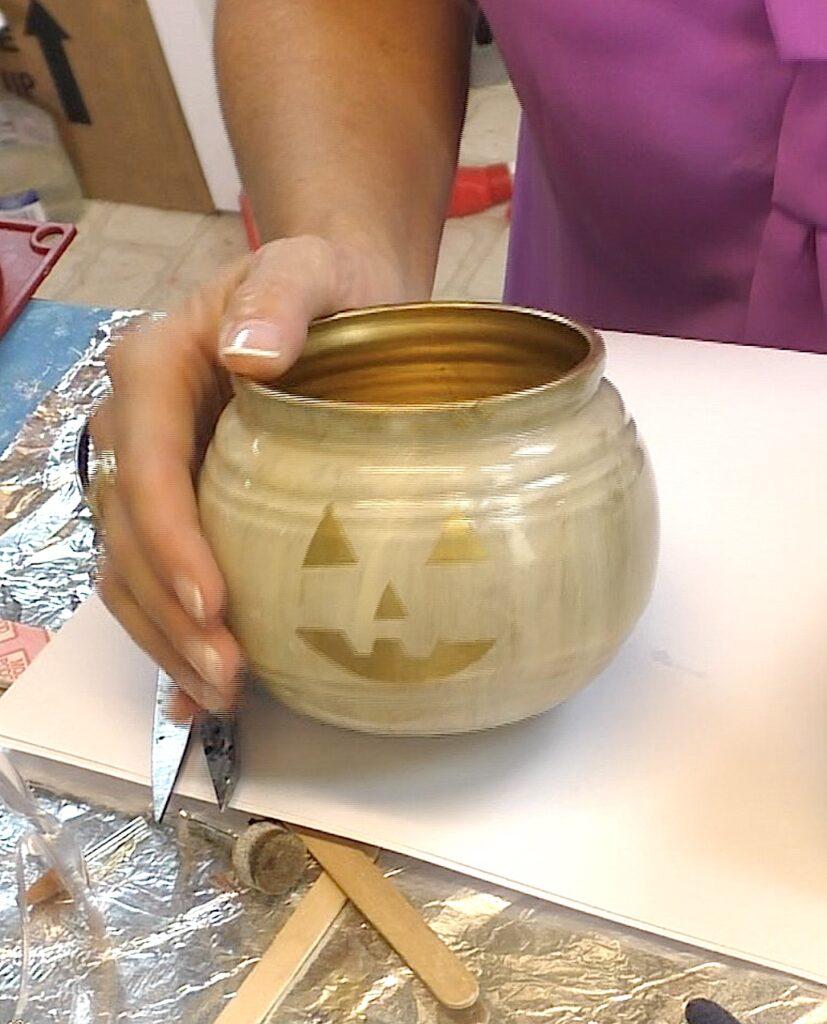 Ivory glass pumpkin jar with gold face