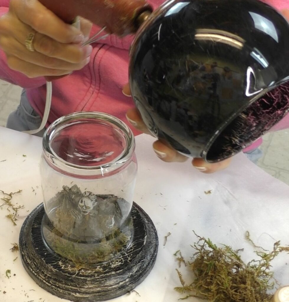 Glue the black crackled votive to the bottom of the upside down glass for the DIY easy Halloween decorations