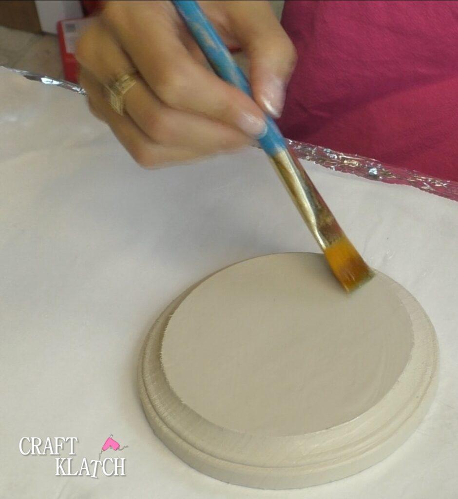 Brush crackle medium over painted wood base