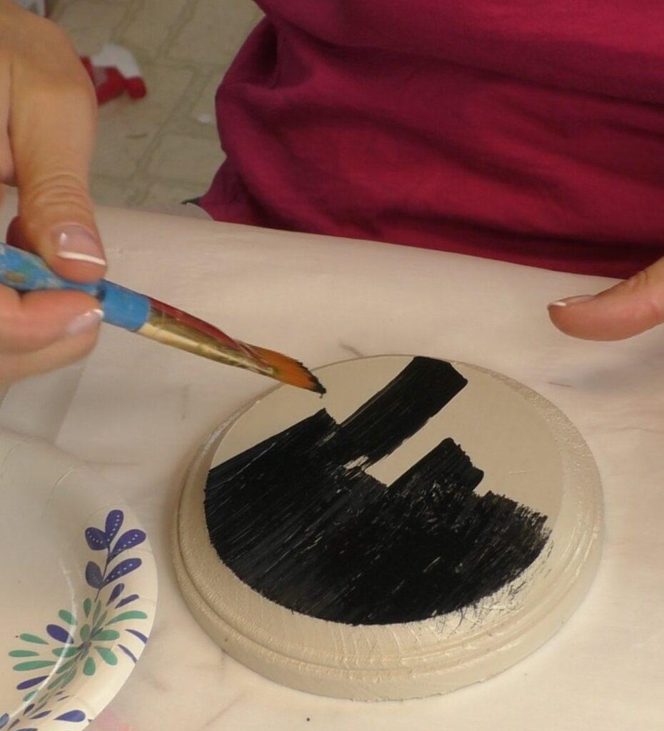 Paint black paint over the crackle medium