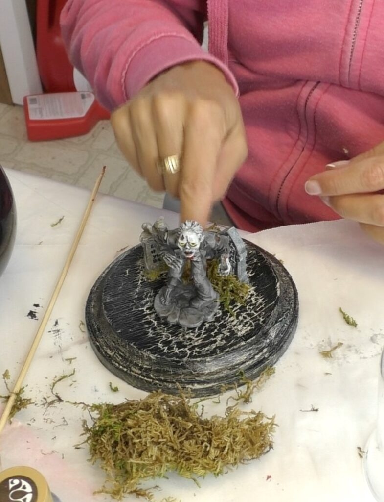 Glue moss at the bottoms of the gravestones and the zombie for the cemetery decor zombie votive