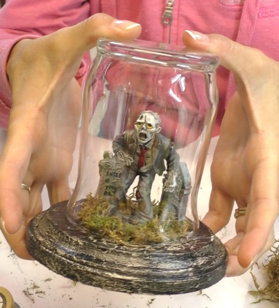 Put glass upside down over the zombie. It's like a cemetery decor terrarium which makes diy easy halloween decorations