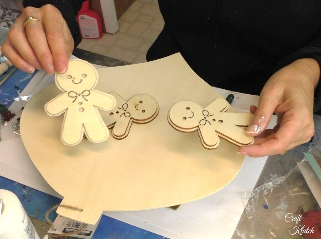 Holding unfinished wood gingerbread men