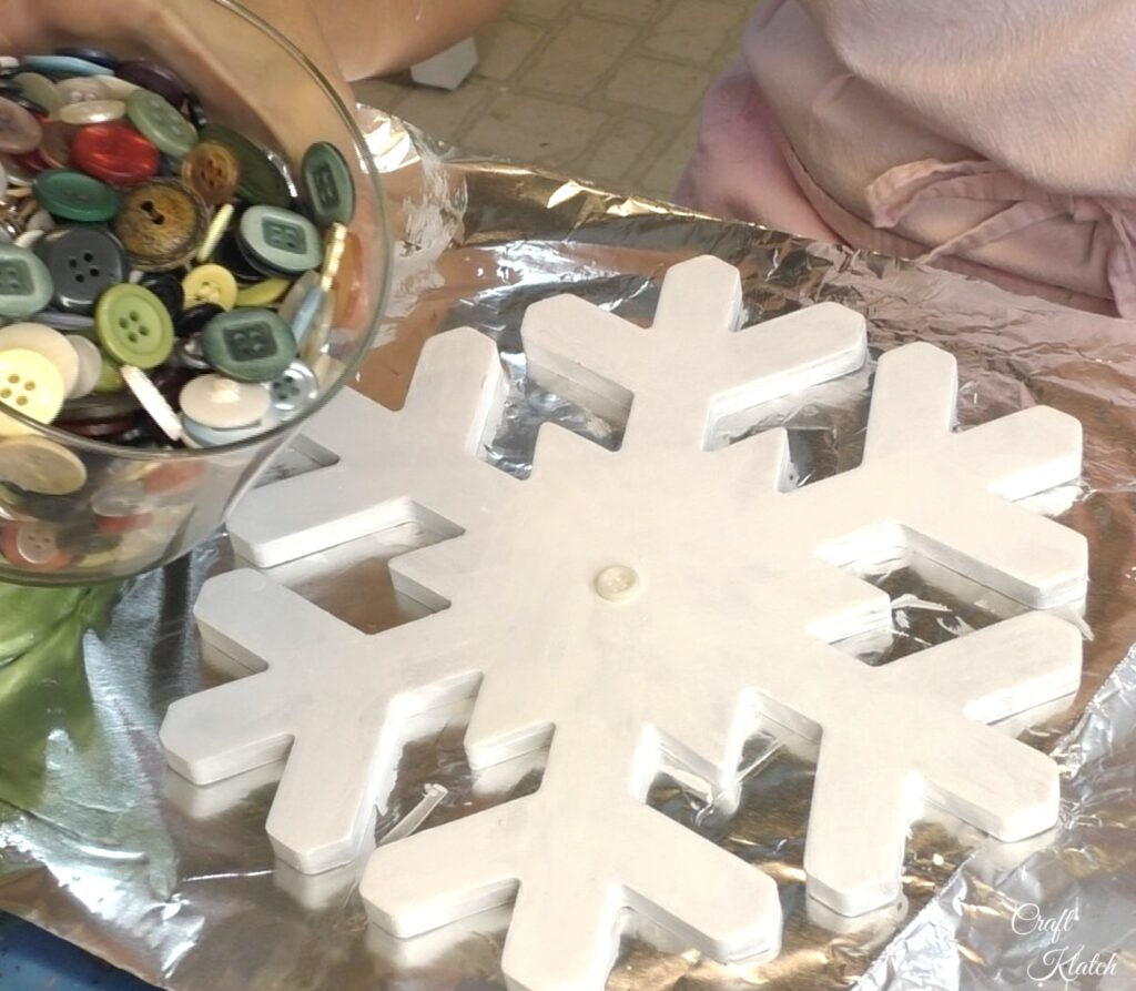 Jar of buttons and white snowflake