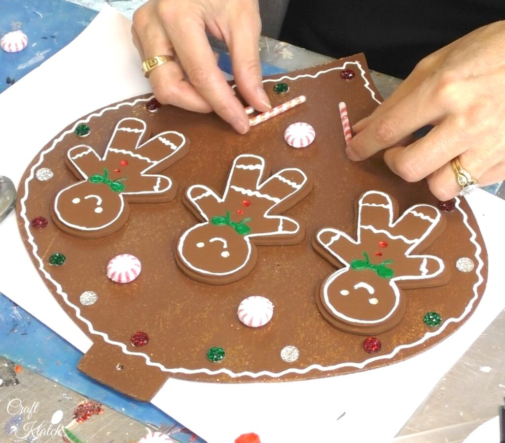 Add candy canes to the gingerbread ornament