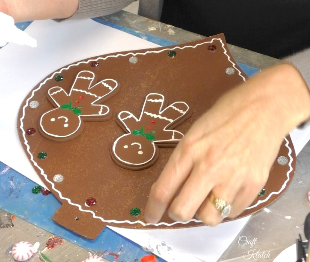 Add gems for a bit of sparkle on the gingerbread Christmas ornament copy