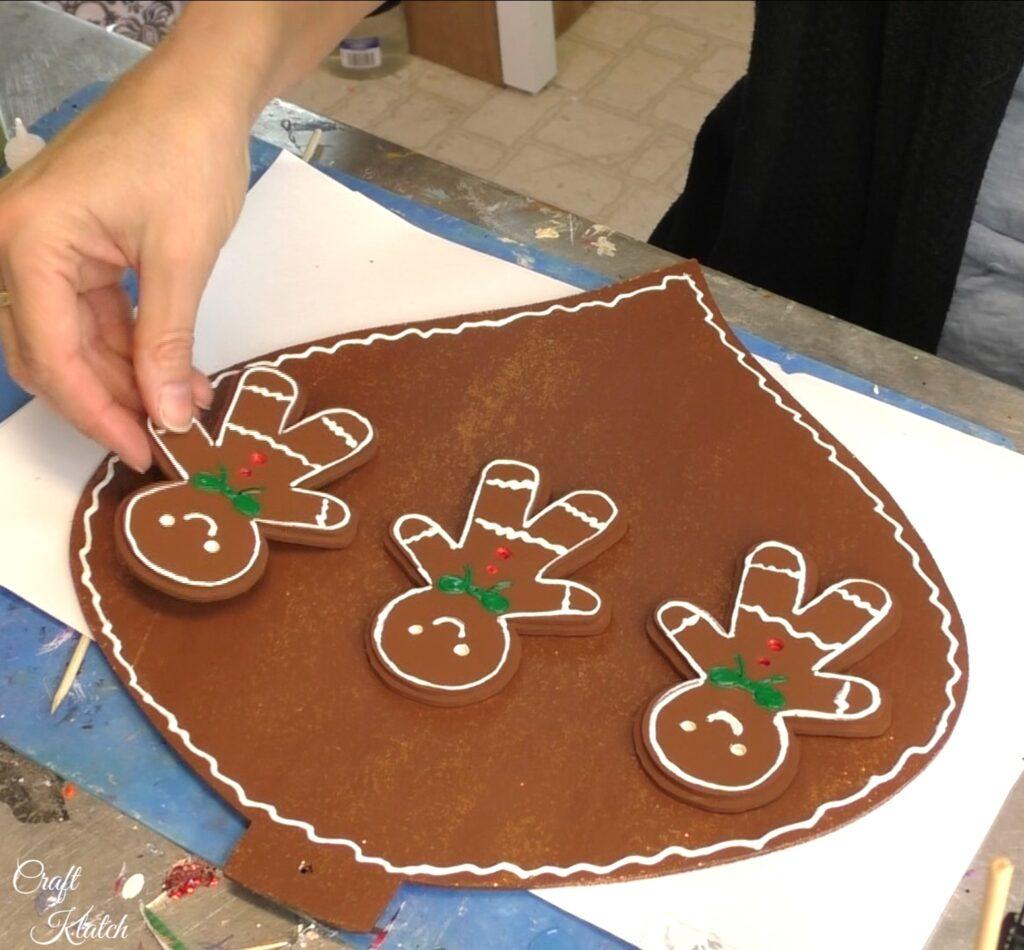 Arrange gingerbread men on ornaments