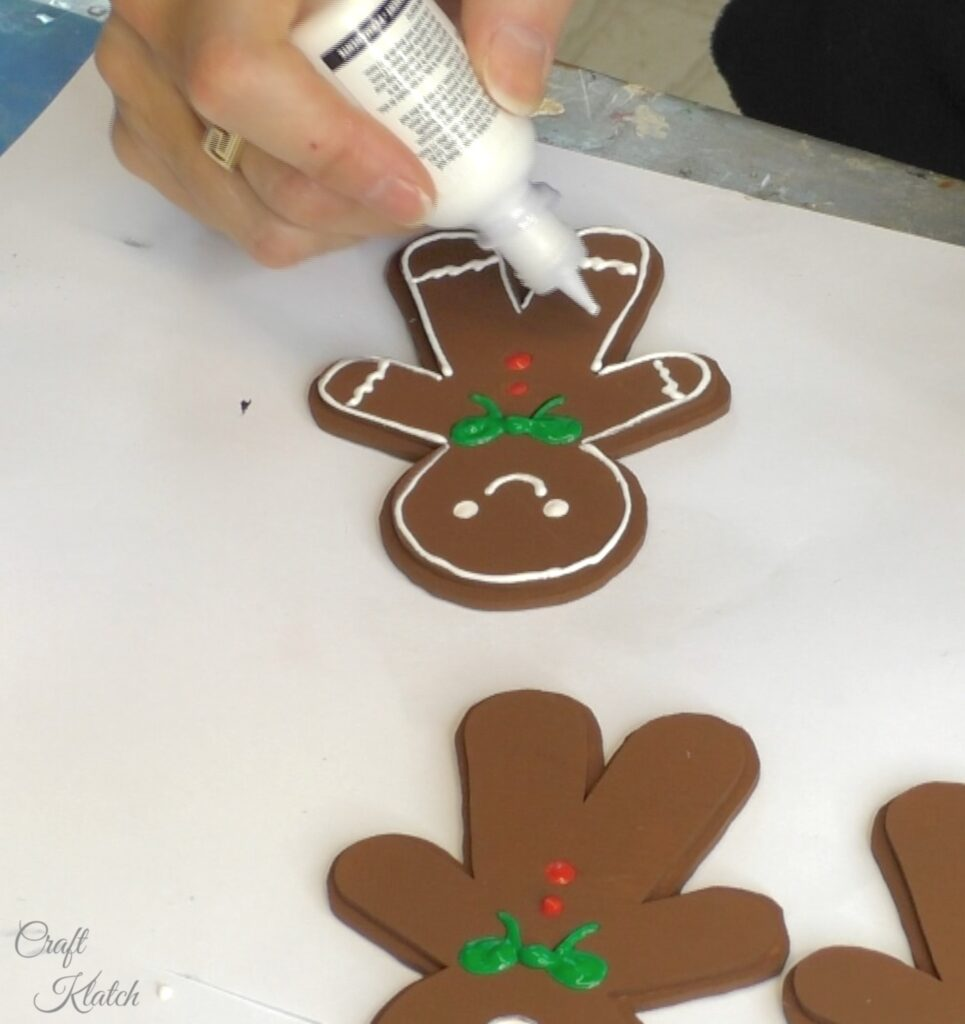 Decorating gingerbread men with fabric paint