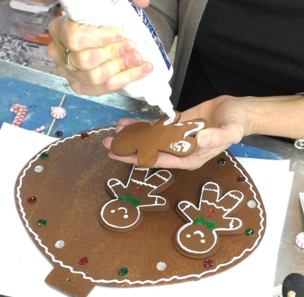 Glue gingerbread man onto Christmas ornament
