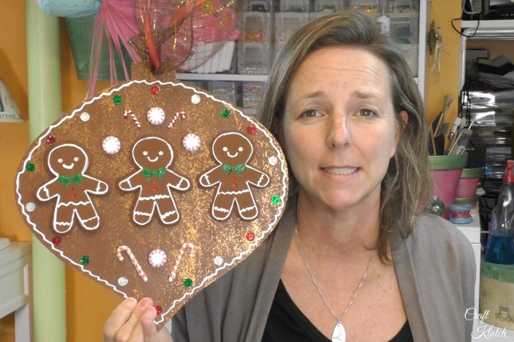 Mona holding gingerbread Christmas ornament diy