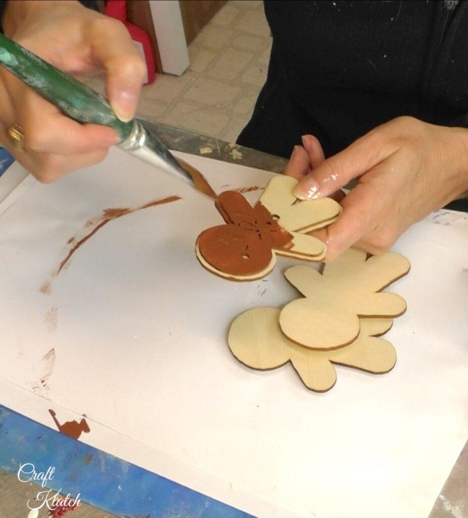 Painting gingerbread men ornaments brown