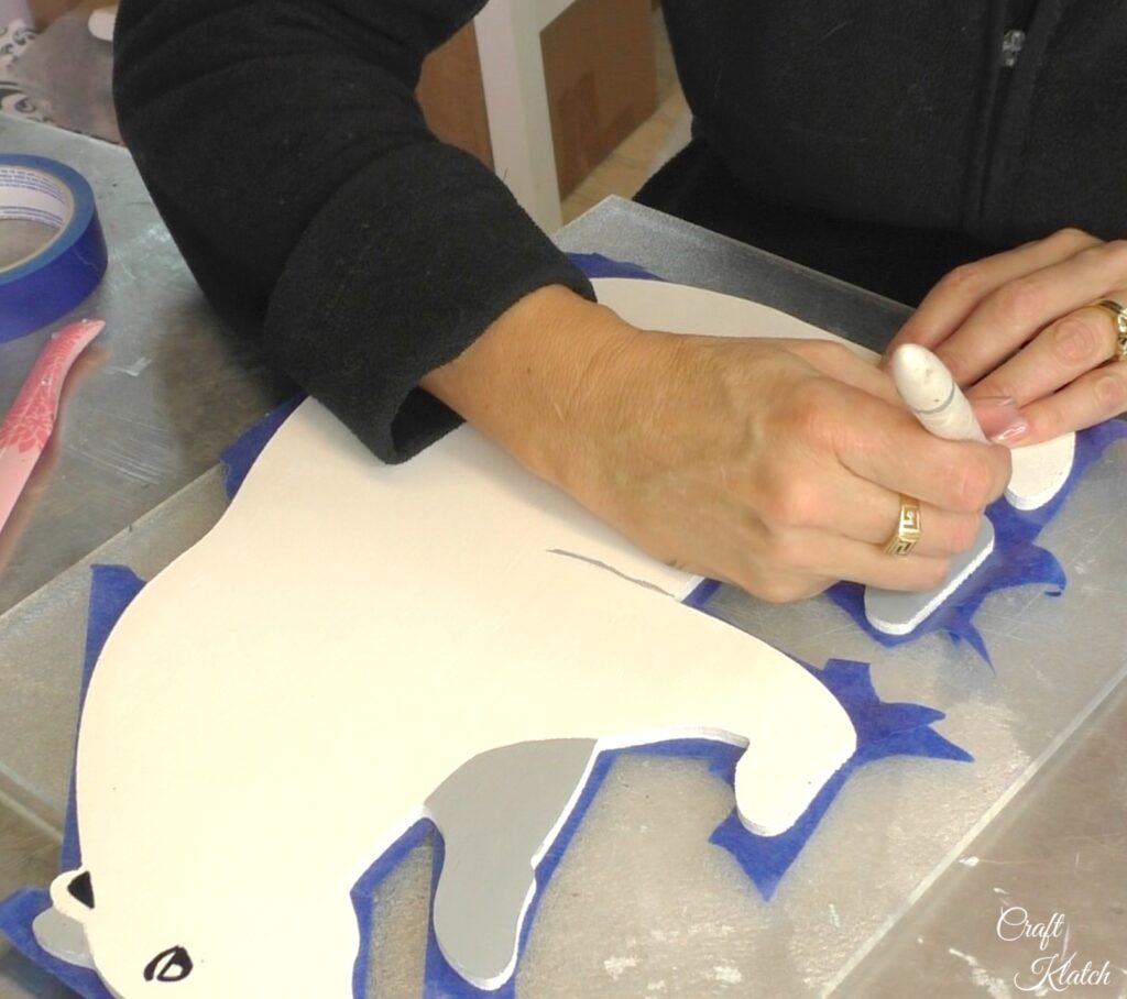 Cut off excess tape with a craft knife