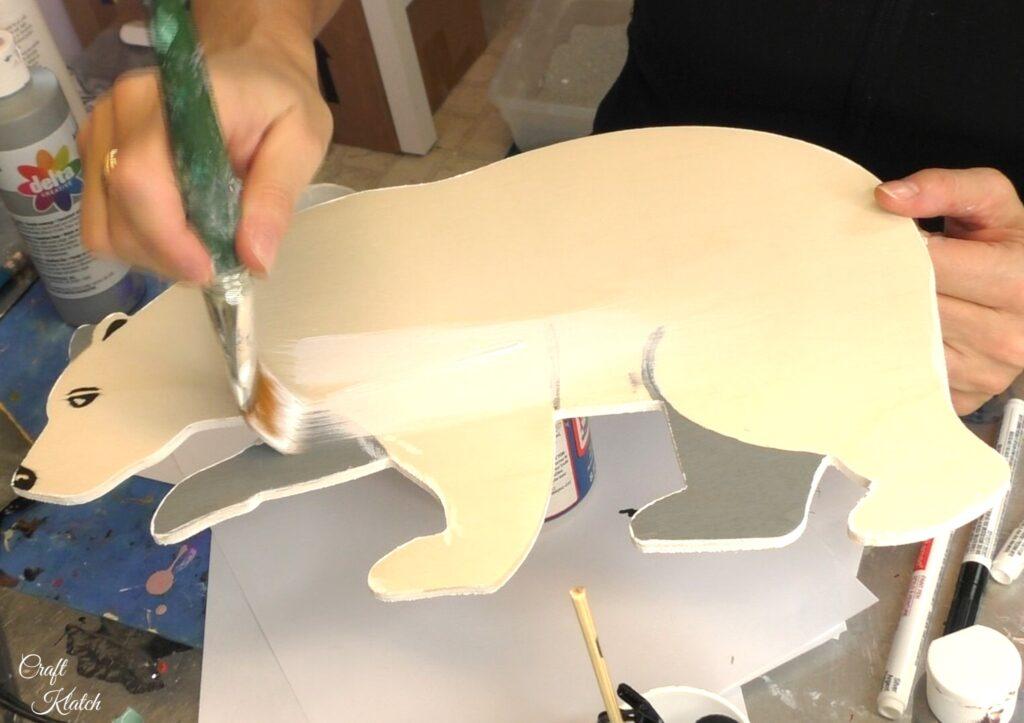 Paint white over front of polar bear