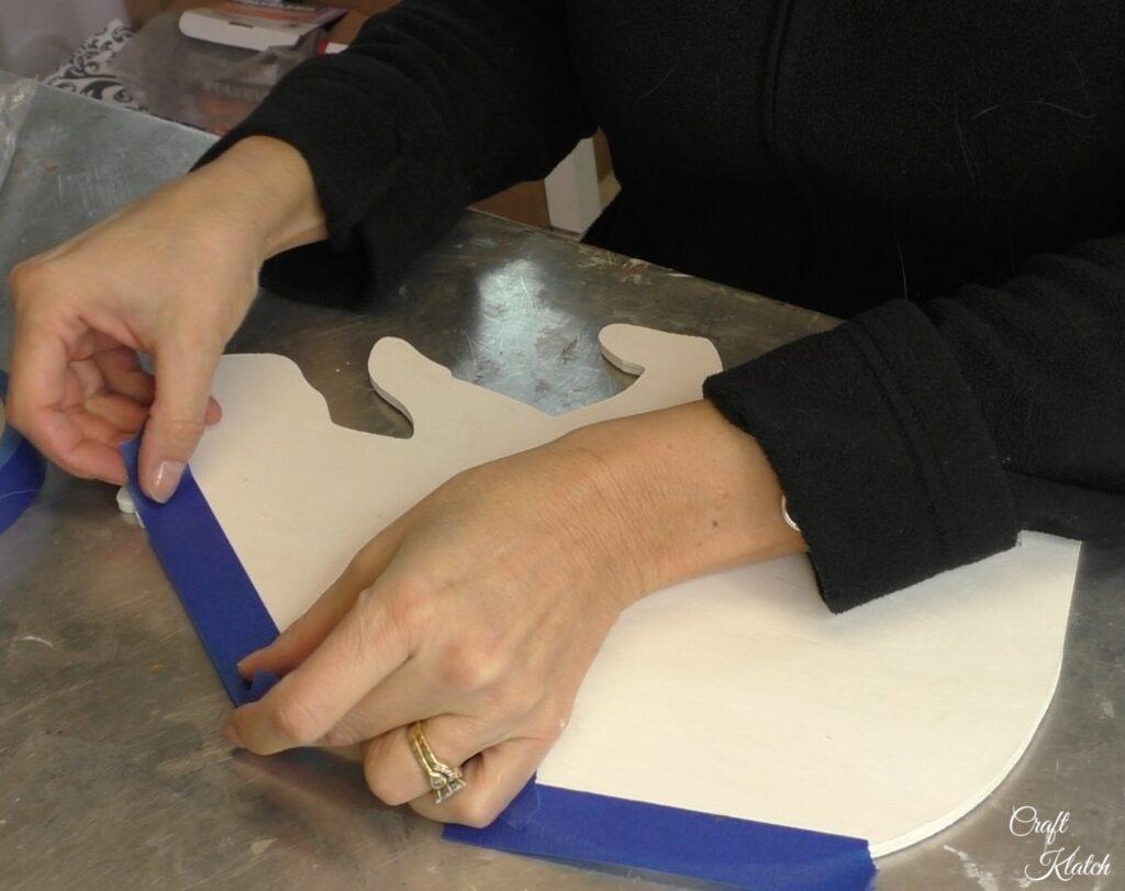 Line bottom edge of polar bear with painter tape
