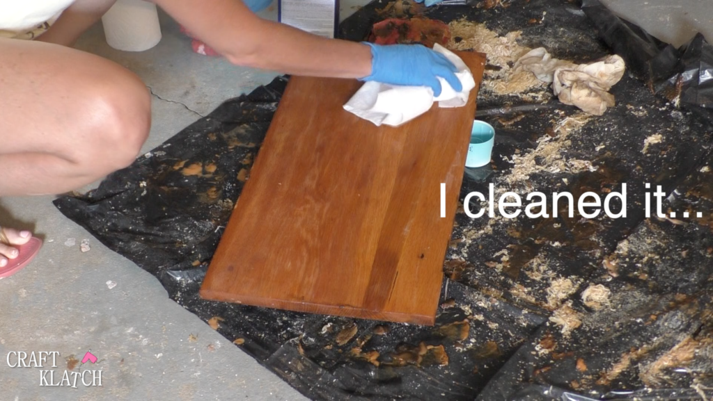 Cleaning desk with acetone after stripping off