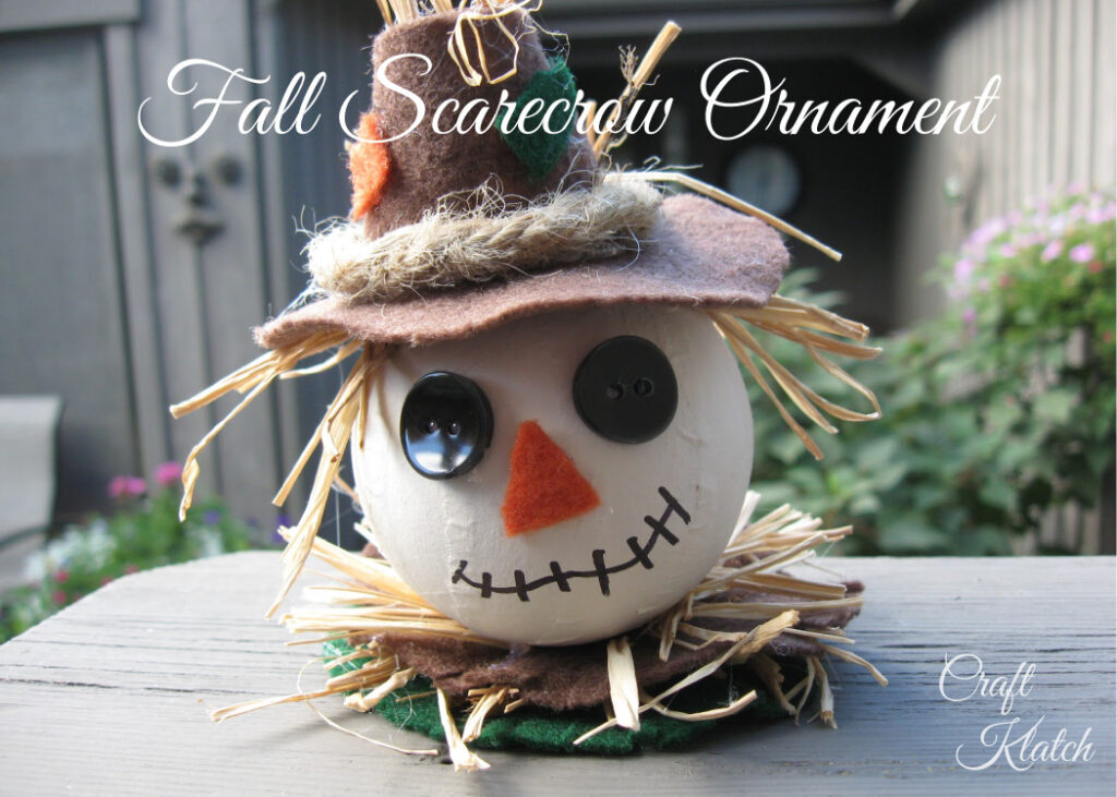 Scarecrow ornament craft with button eyes, felt nose and hat