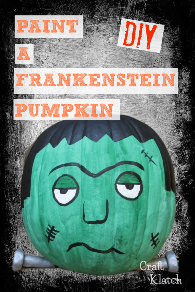 Frankenstein painted pumpkin craft with green face, black hair and silver bolts