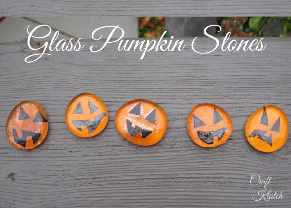 Five orange glass stone pumpkins