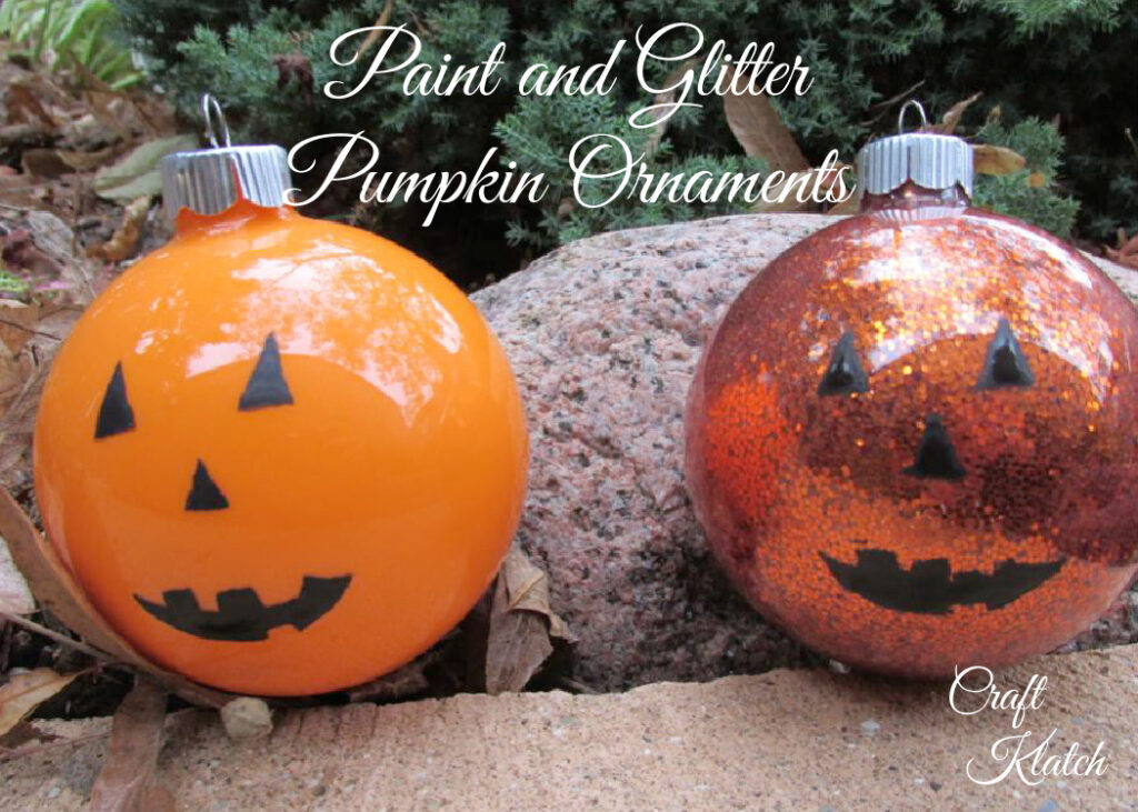 Two orange pumpkin ornament crafts one with glitter and one with paint