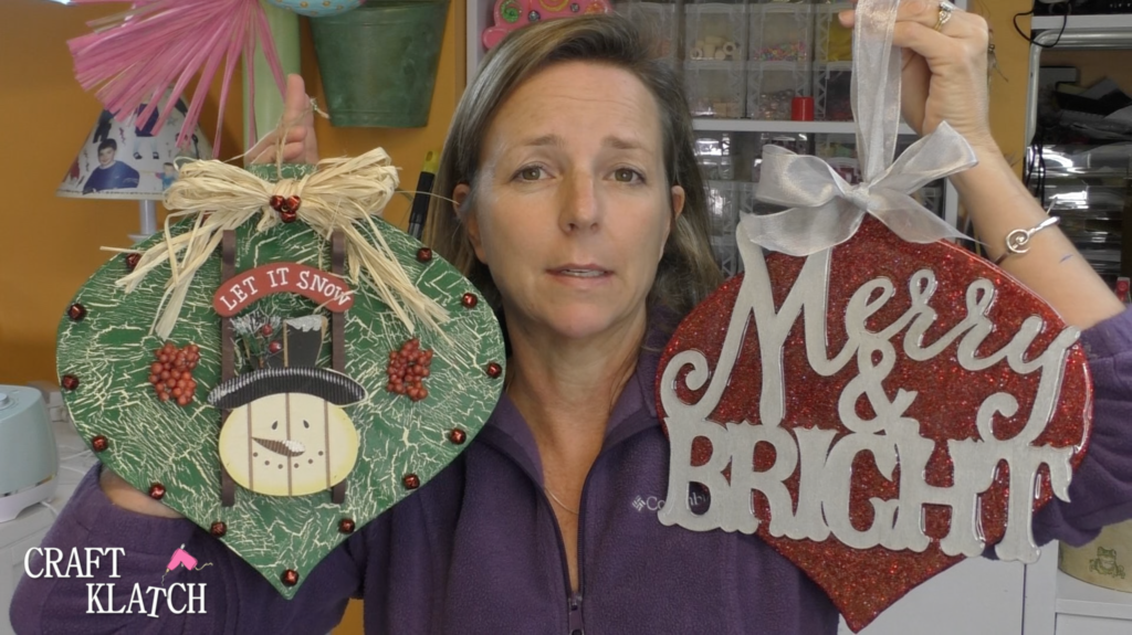 Mona holding up two Dollar Tree ornament makeovers