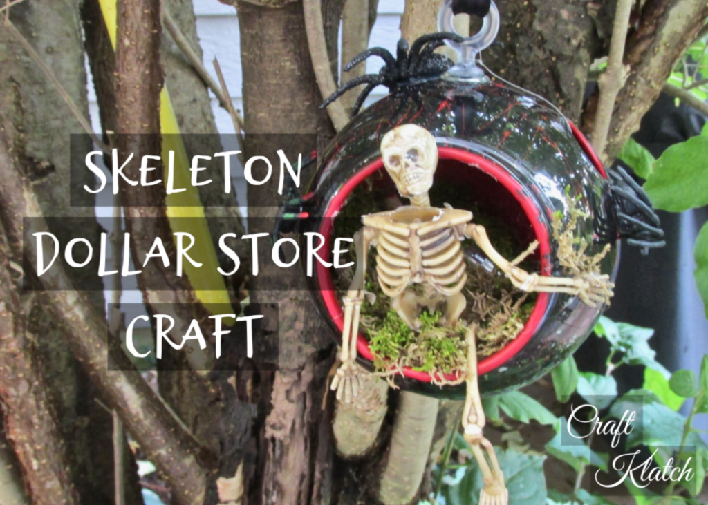 Skeleton dollar store craft ornament with skeleton climbing out of a black orb