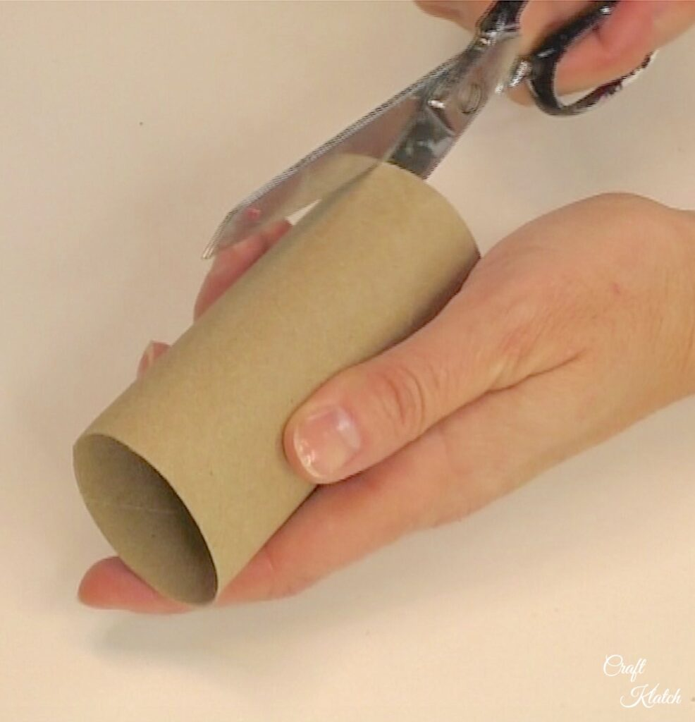 Cut toilet paper roll lengthwise
