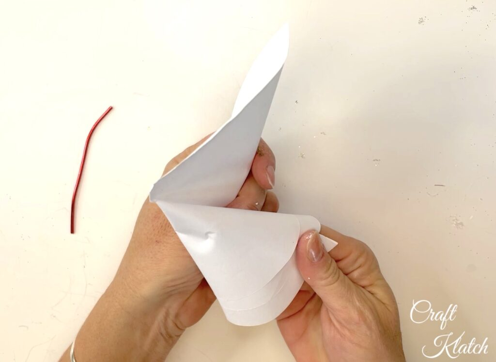 Roll the paper circle into a cone