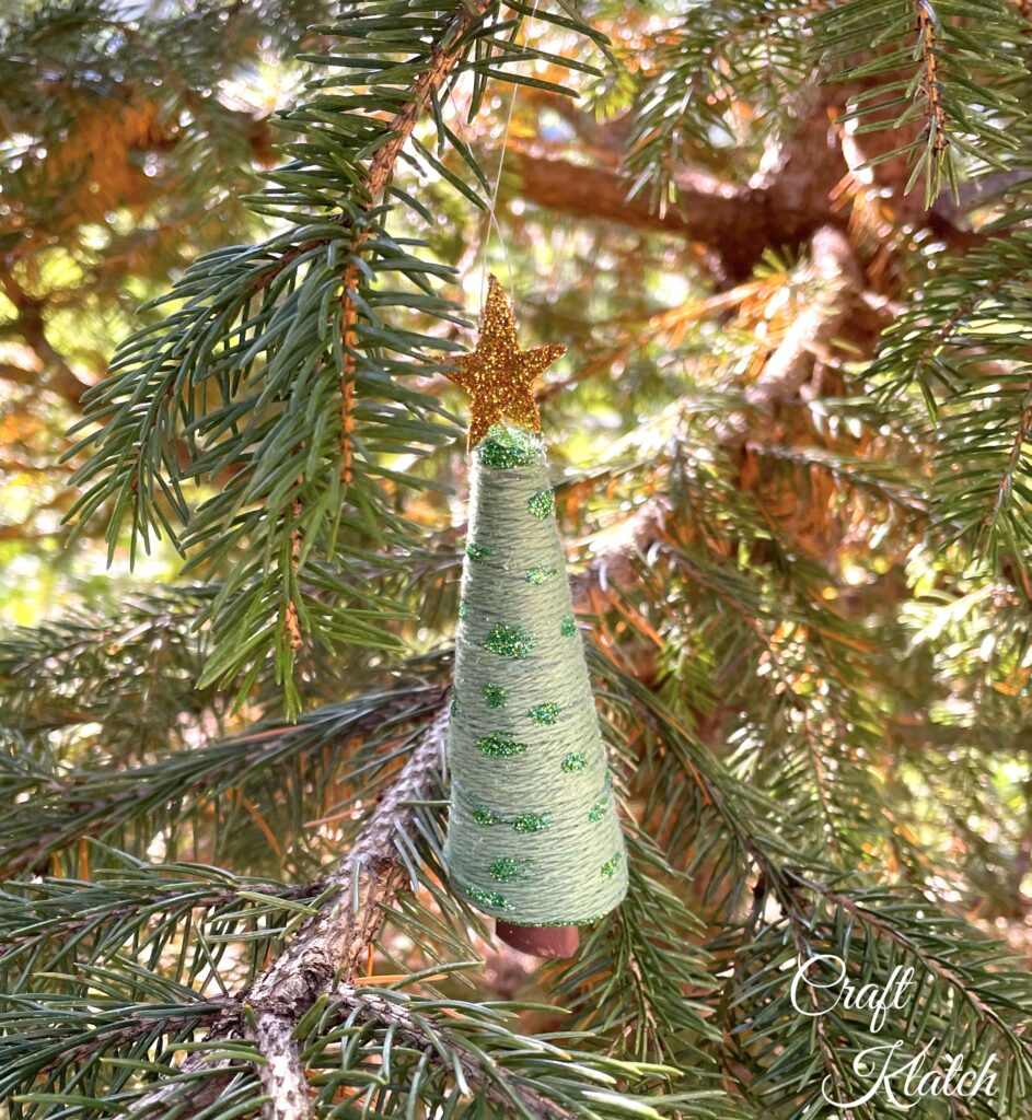 Christmas tree ornament hanging in tree