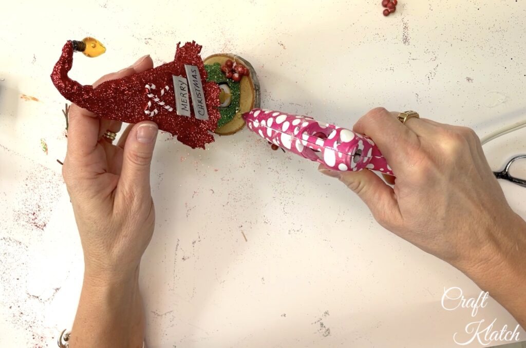 Glue on red berries to the how to make an enchanted birdhouse christmas ornament