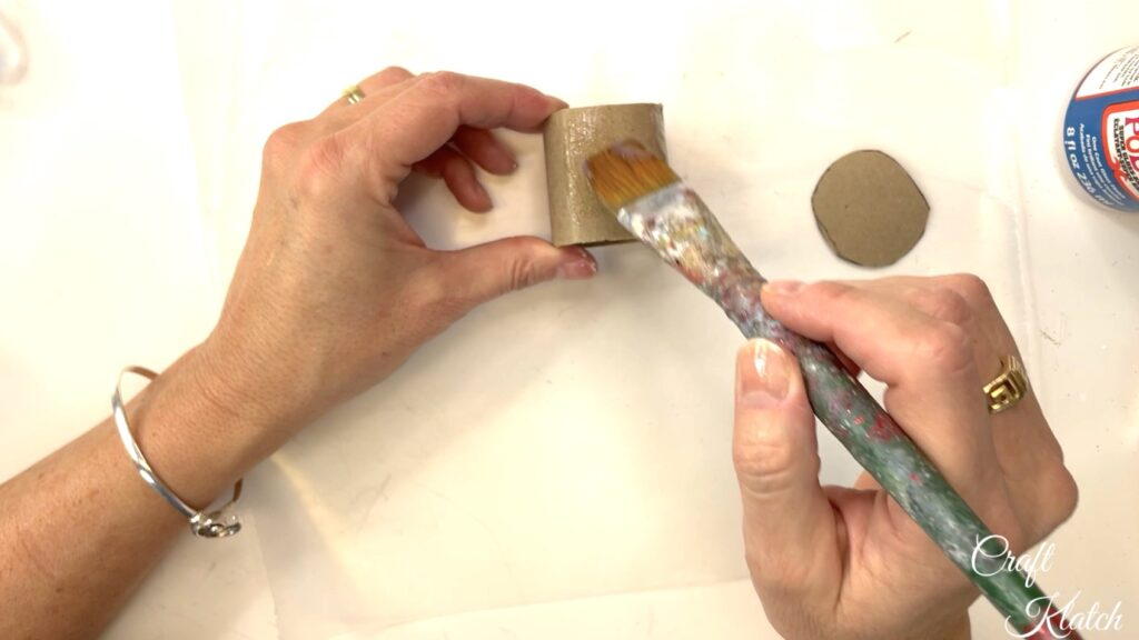 Brush toilet paper roll with Mod Podge or clear drying glue