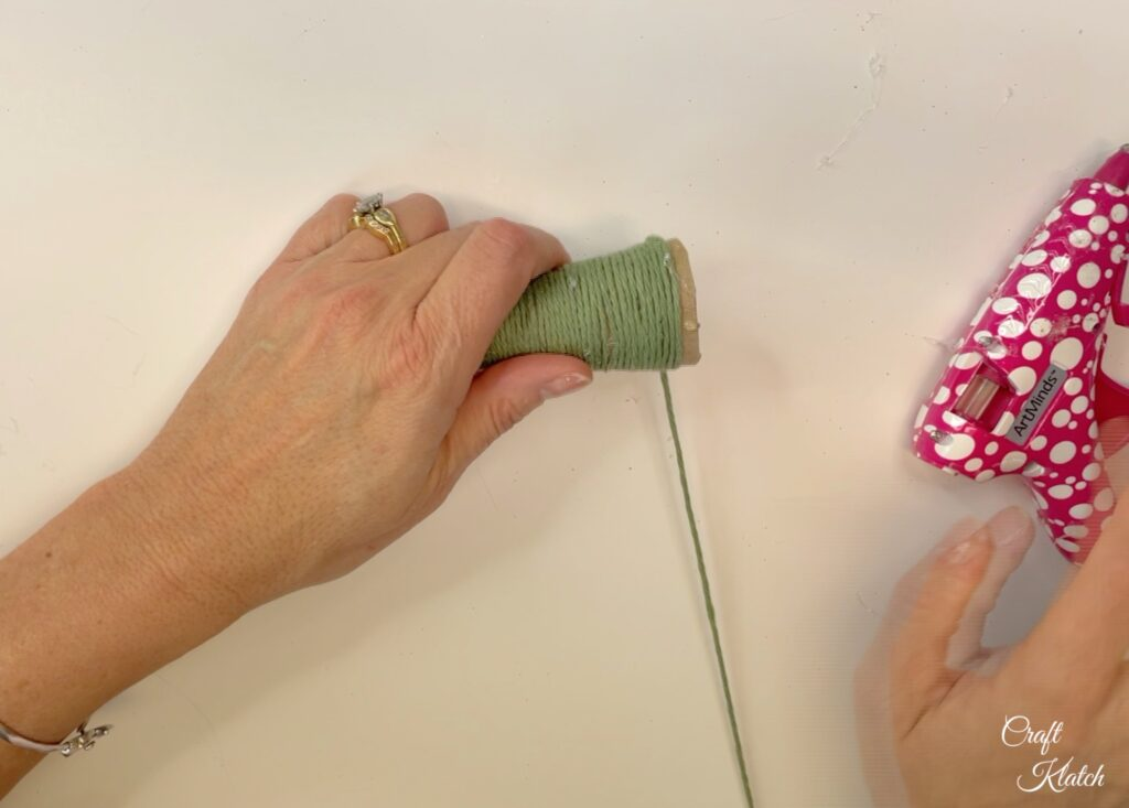 Wrap yarn around toilet paper craft Christmas tree ornament