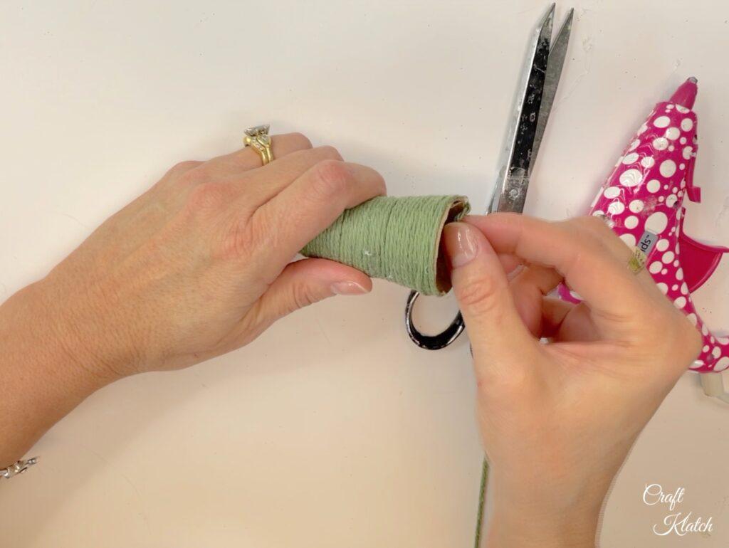 Trim the yarn and glue the edge