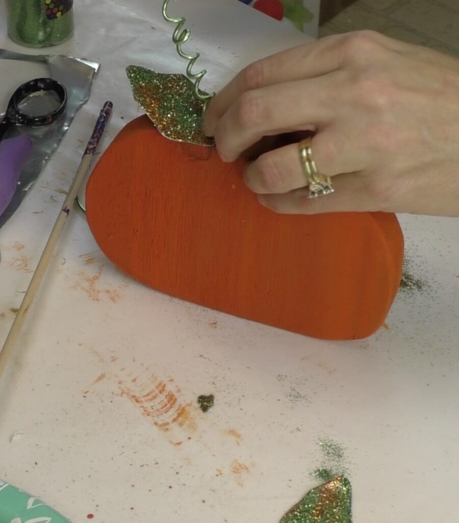 Adding wire tendril to wood pumpkin