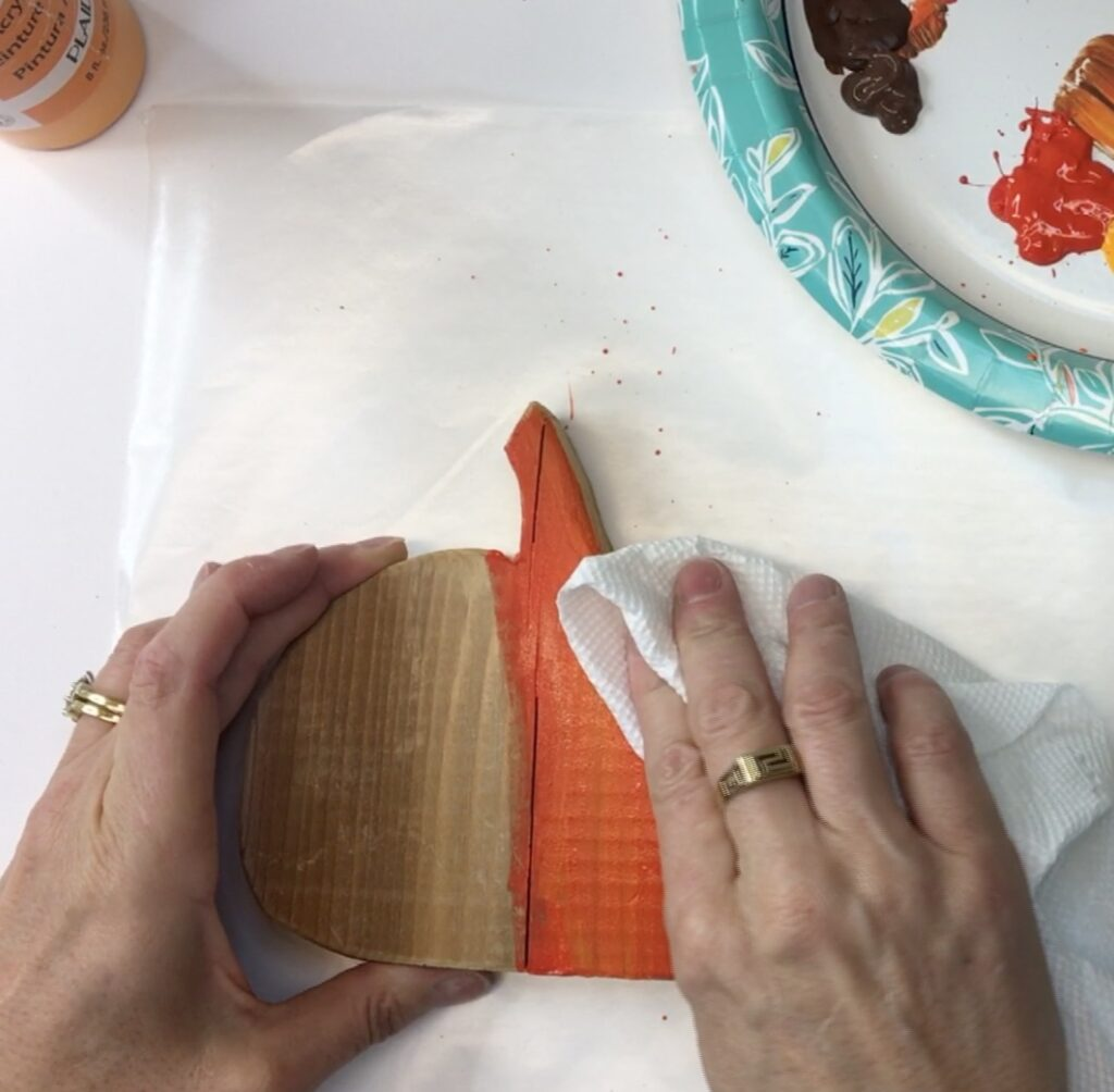 Wiping excess paint off of Thanksgiving craft
