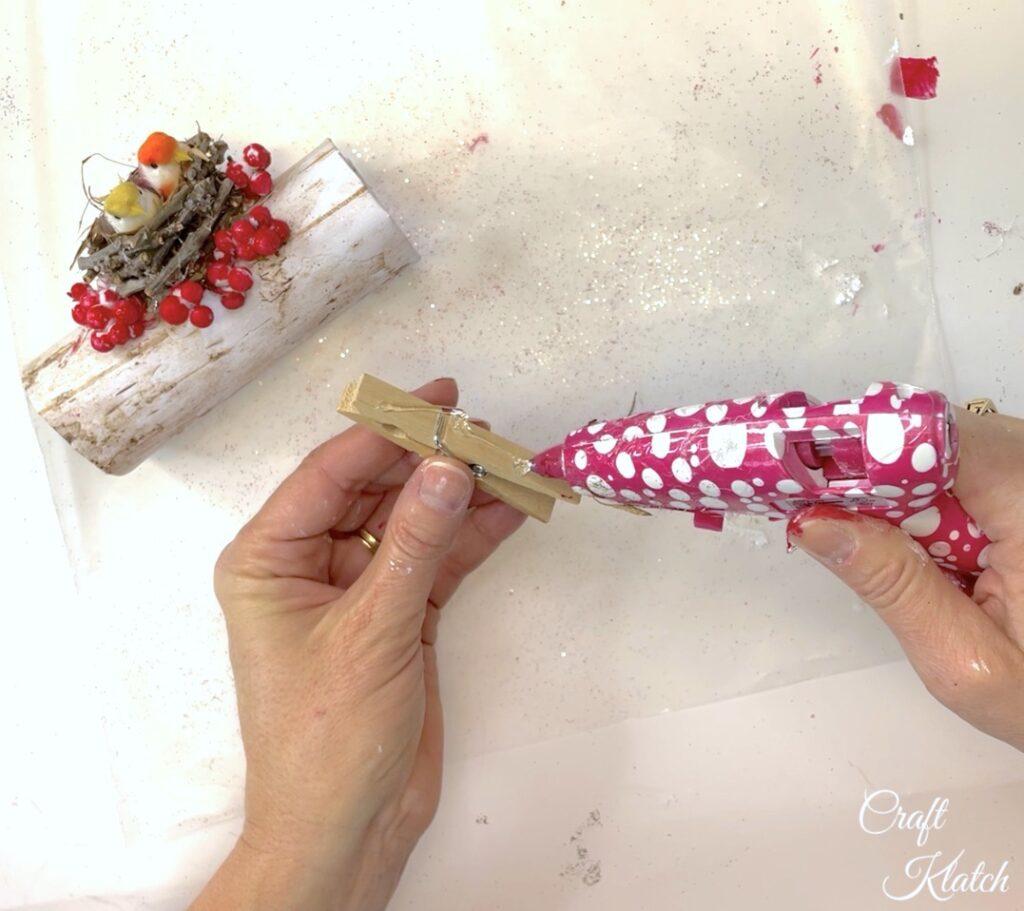 Hot glue clothespin to the bird Christmas tree ornament diy copy