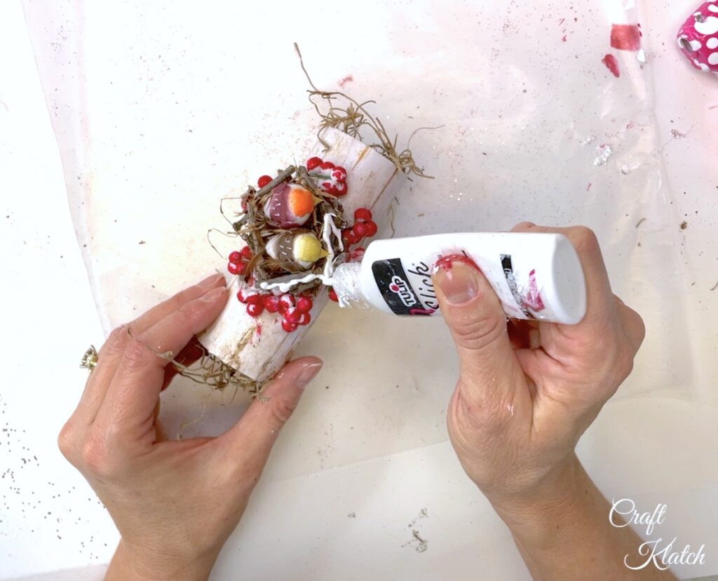 Add dimensional white paint for snow on the bird Christmas ornament