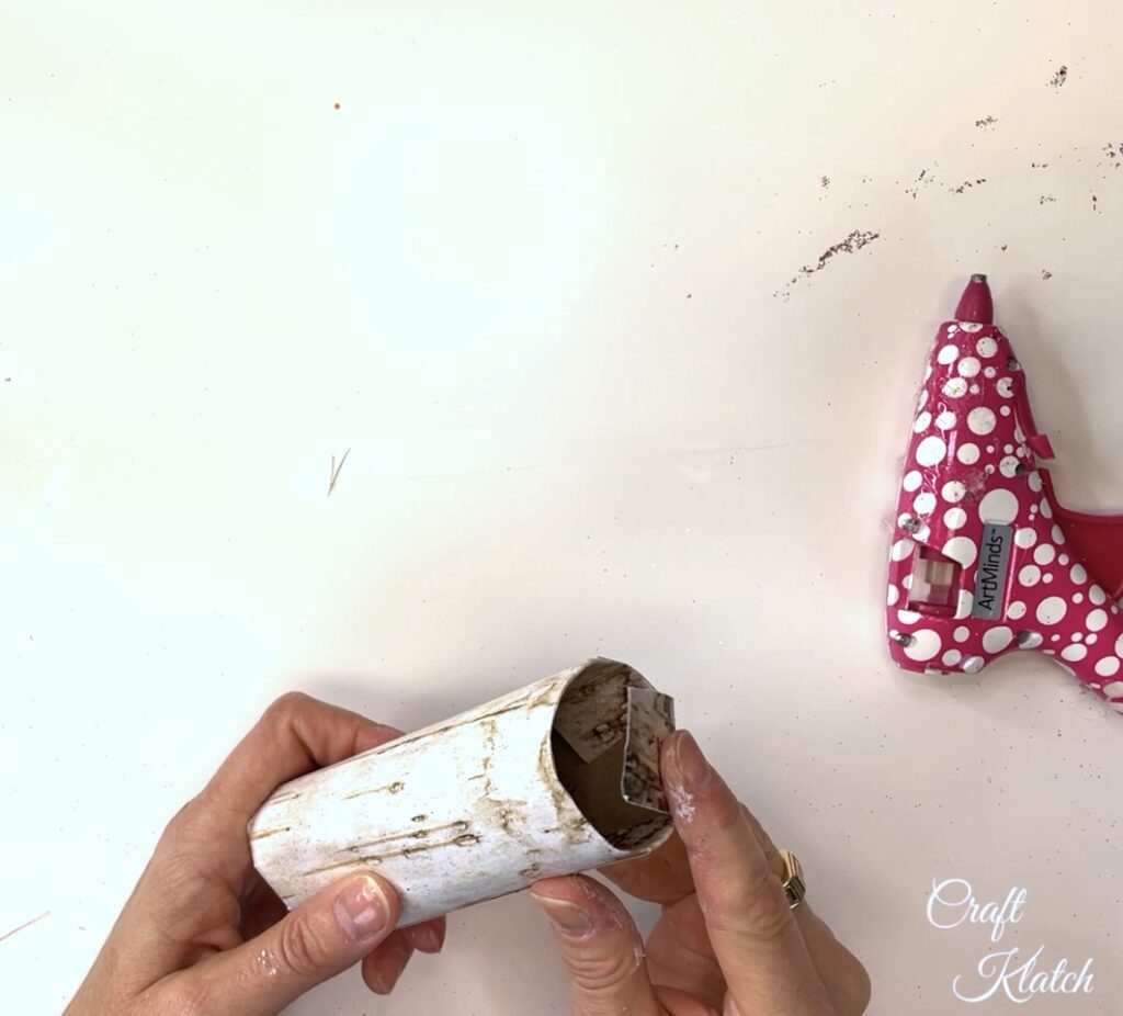 Fold flaps down into the toilet paper roll for the bird Christmas tree ornament
