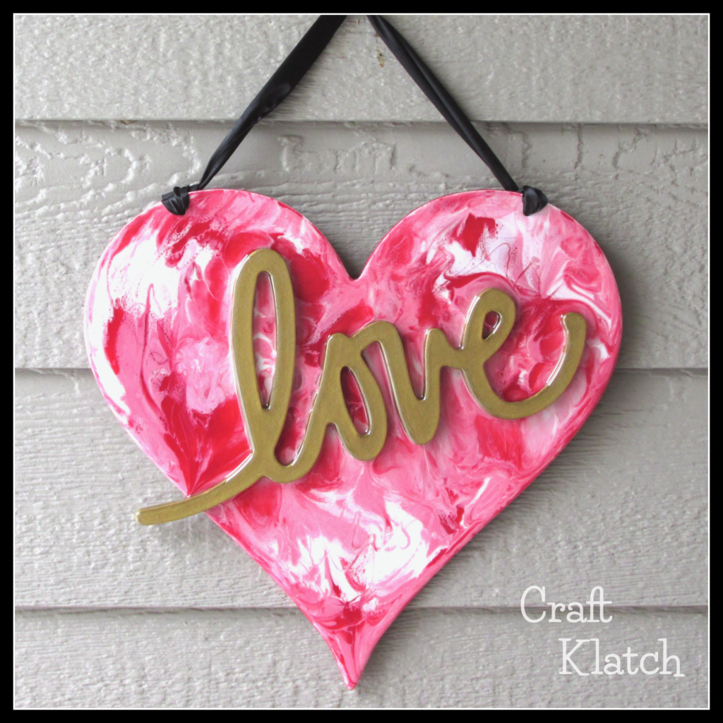 DIY Valentine's Day Resin heart art with black ribbon
